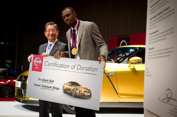 COO Toshiyuki Shiga and Usain Bolt at Nissan HQ.